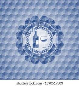 bottle and glass of wine icon inside blue emblem or badge with geometric pattern background.