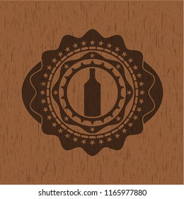 bottle icon inside badge with wooden background