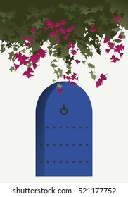Bougainvillea flowers and blue door in traditional mediterranean house