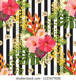 Bouquet of tropical plants on a striped background seamless pattern