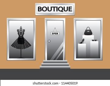 Boutique front. Exterior shop windows with mannequin, shoes, bag and glasses