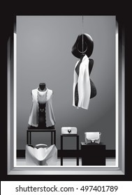 Boutique window with mannequins in black and white colors