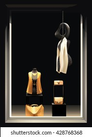 Boutique window with  mannequins in yellow clothes and with a yellow bag