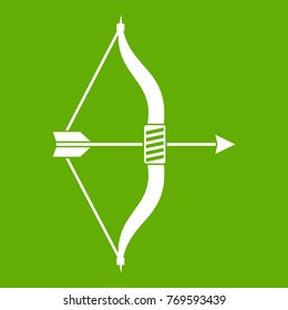 Bow and arrow icon white isolated on green background. Vector illustration