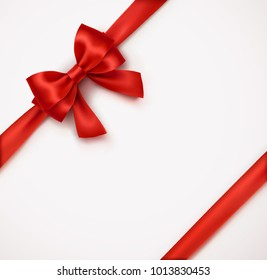 Bow and red satin ribbon isolated on white background. Vector xmas silk tape, decor wrap element. Red gift bow template for Christmas, New Year holiday card design.