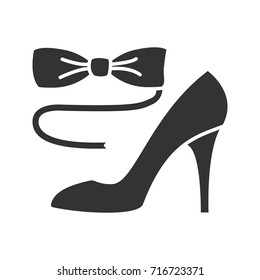 Bow tie and high heel shoe glyph icon. Silhouette symbol. Party dress code. Negative space. Vector isolated illustration