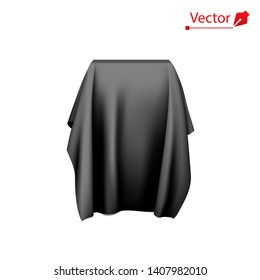 Box covered with black fabric. Surprise, award, prize, presentation concept. Reveal a hidden object. Raise the curtain.