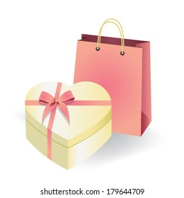 box as heart form with a gold bow and bag for a gift on a white background