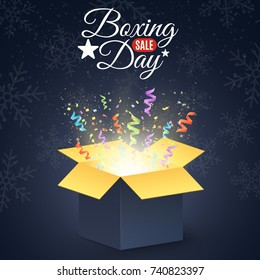 Boxing day. Winter sale. Open dark gift box. Confetti and colorful multicolored ribbons. Christmas present on a dark background. Snowflakes on the background. Vector illustration
