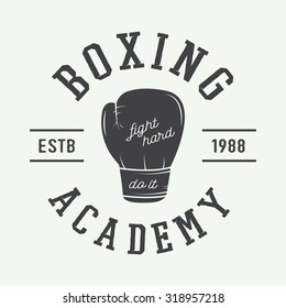 Boxing and martial arts logo, badge or label in vintage style. Vector illustration