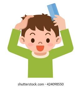 Garçon peigne les cheveux avec un peigne