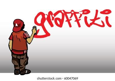 Boy drawing a graffiti on the wall
