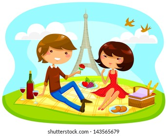 boy and girl having romantic picnic next to the Eiffel tower
