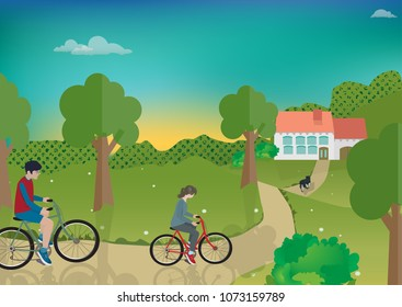 Boy and girl riding on bicycle to house in the village. The background is sky, forests and hills