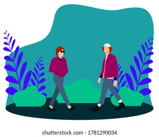 Boy and girl walking in the park and garden