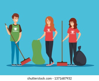 boy and girls volunteers with brooms and trash bag
