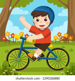 A boy in a helmet having fun in spring park with his blue bicycle on beautiful day.