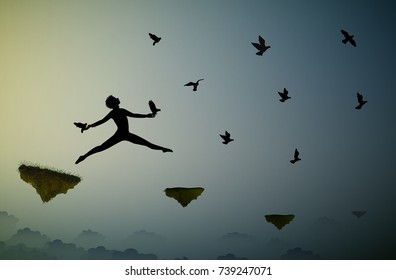 boy jumping and holding pigeons, fly in the dream land, bird-man, shadows, life on flying rock, silhouette.