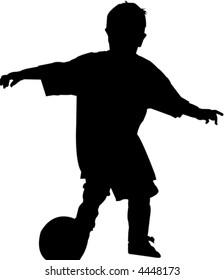 Boy kicking soccer ball silhouette