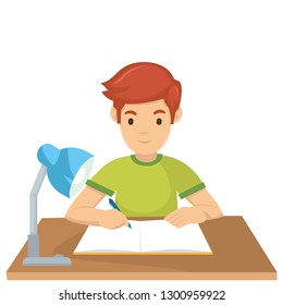 A boy learn on the desk before exam tomorrow