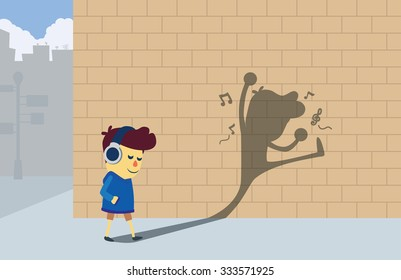 A boy listening music by headphones and walking to the corner street but his shadow look like he dancing and so happy.