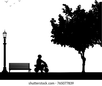 Boy rides on a motorcycle toy in park, one in the series of similar images silhouette