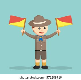 boy scout holding semaphore flags