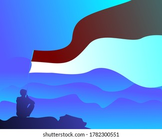 A boy sitting in a abyss and holding an Indonesian or Monaco flag