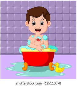 Boy sitting in a bathtub filled with bubbles in a bathroom
