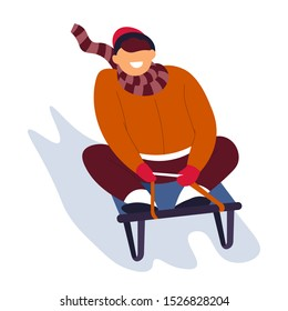 Boy sliding on sled, sledge down hill, laughing, wearing red warm clothes, striped scarf, beanie hat. Front view. Winter holidays vacation activity. Isolated vector illustration, white background.