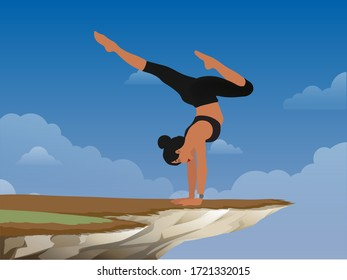 brave girl practices yoga in a pose on a rock