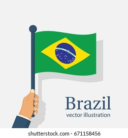 Brazil flag holding in hand. Brazil Independence Day 7 september. Vector illustration flat design. Isolated on white background. National holiday. Celebrated annually. Waving flag in wind.
