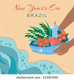 Brazilian New Years Eve tradition. Dark-skinned person on the beach taking a little blue boat of offerings to sea. Decorated with stars and pearls, with red flowers and a light blue candle burning.