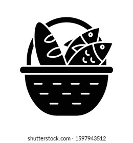 Bread and fish in basket glyph icon. Feeding the multitude. Holy week. Blessing food from Bible. New Testament. Bible narrative. Silhouette symbol. Negative space. Vector isolated illustration