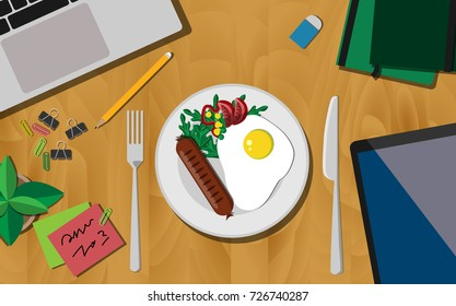 Breakfast first concept, Top view of working desk with plate of breakfast (fried egg with sausage),  laptop, mobile phone, and notebook