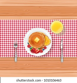 Breakfast food menu with pancakes and berries on wooden table