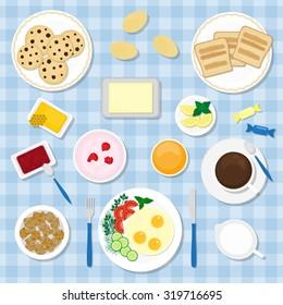 Breakfast with healthy, fresh food. Eggs, yogurt, juice, coffee or tea, toasts, jam jar, butter, milk, cookies, brown sugar, honey, candies.
