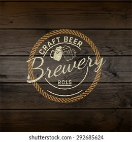 Brewery badges logos and labels for any use, logo templates and design elements for beer house, bar, pub, brewing company, brewery, tavern, restaurant, on wooden background texture