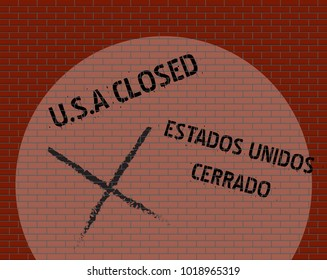 A Brick Wall With Spotlight Separating the U.S.A and Mexico