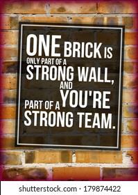 Brick wall with team building phrase