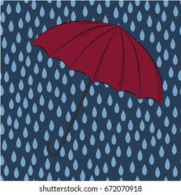 Bright big umbrella on the rainy blue background.