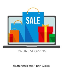 Bright flat shopping bags and boxes on laptop screen and at the front. Group of red, green and blue paper pockets. Signs for online shop or store. Isolated on white background, with place for text.