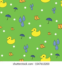 Bright green seamless background pattern with yellow ducks and blue umbrellas
