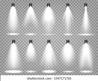 Bright light beam. Vector spotlight set.   Transparent realistic effect. Stage lighting. Illuminated studio spotlights.