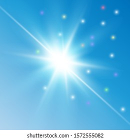 Bright light. Sun flare. Explosion of colors in the blue sky.