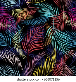 Bright multicolored pattern of leaves of palm trees on a dark background