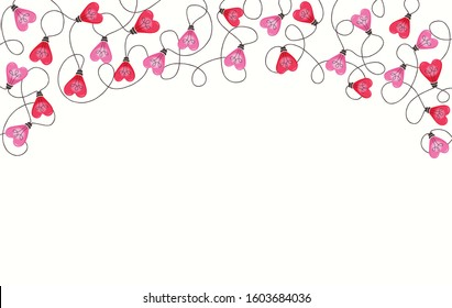 Bright Pink Colorful Valentine's Day Holiday Intertwined Heart Shape String Lights on White Background Top Frame Design Element. Cute Festive Holiday Copy Space Banner for Greeting Cards and Web