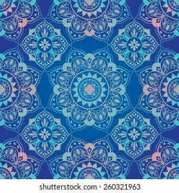 bright, seamless, blue, vector background with ornament of mandalas.