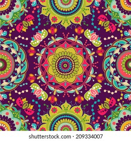 Bright seamless pattern in paisley style. Indonesian batik. Vector wallpaper with paisley and stylized flowers. Design for web, fabric, textile, cover, invitation, poster, wrapping paper