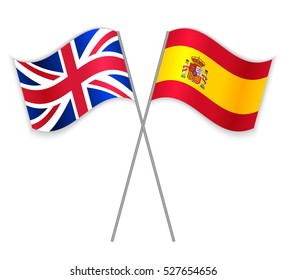 British and Spanish crossed flags. United Kingdom combined with Spain isolated on white. Language learning, international business or travel concept.